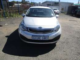 Finance available for 2014 Kia Rio,silver in color,4 doors ,46 000km