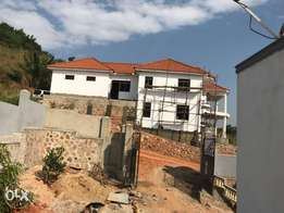 House in kitende at 26decimals at 480m with 7bedrooms all self contain