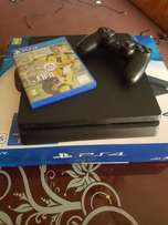 6 months old PS 4 Slim with FIFA 17 for urgent sale