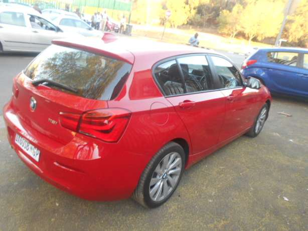 BMW 118i, 2015 model, Red in color, Automatic with a sunroof for sale Johannesburg - image 4