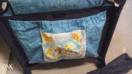 Camping cot with its netting& light for sale that plays tunes