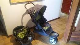Chelino Pram, 3 wheels, one handed fold with back facing car seat.