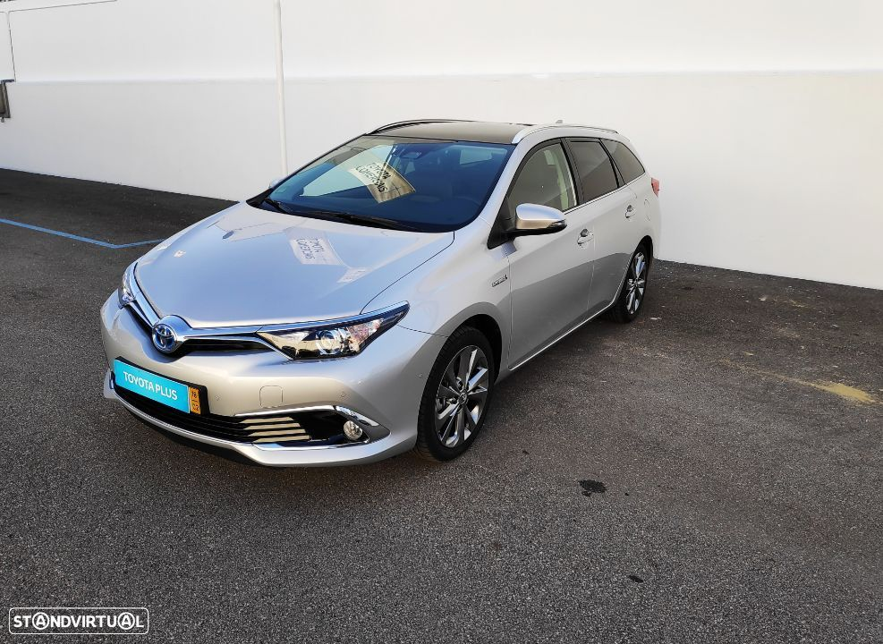Toyota Auris Touring Sports 1.8 Hybrid Exclusive + Navi - 1