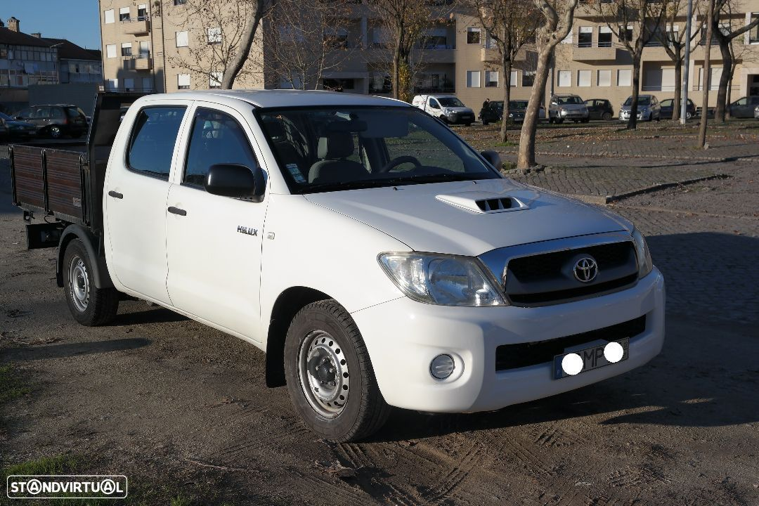 Toyota Hilux 5 lugares - 1