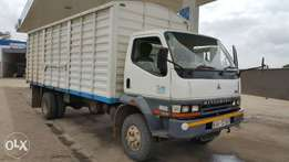 Mitsubishi FH its 2006 Local has a cover body