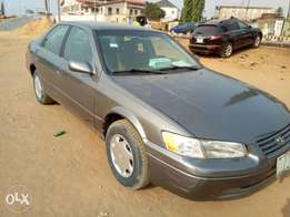 A first body and neatly used, 1999 Toyota camry, ac, cd, fabrics etc.