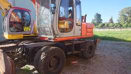 2002 Hitachi EX 135W Wheel Excavator with grab