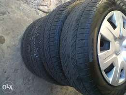 14inch steel rims with very good tyres(185/60/14) came of toyota