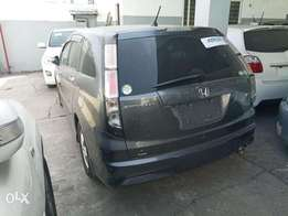 Grey colour Honda stream with alloy rims 2010 model. KCP