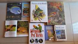 Selection of books on parrots and fish