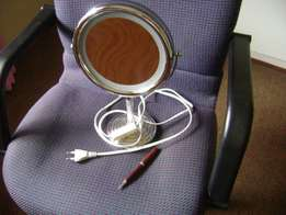 Magnified lighted makeup mirror