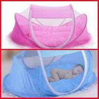 Baby comforter net with a mattress and a pillow