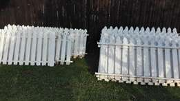 Wooden picket fence, strongly build on metal frame