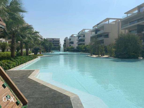 ground apartment with garden for sale in lakview residence new cairo