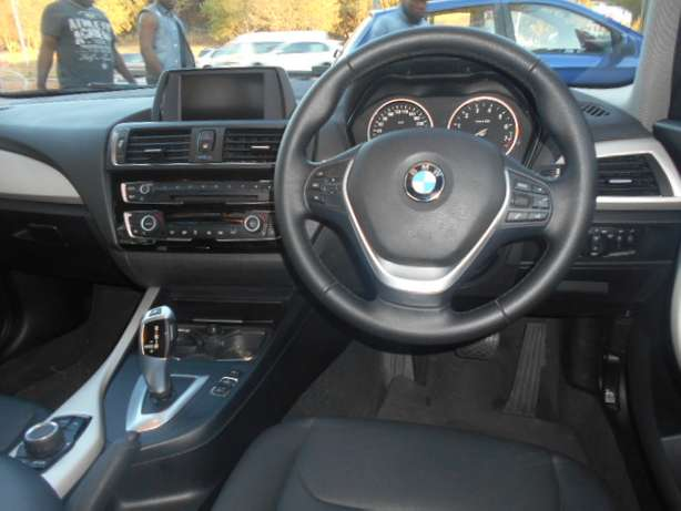BMW 118i, 2015 model, Red in color, Automatic with a sunroof for sale Johannesburg - image 8
