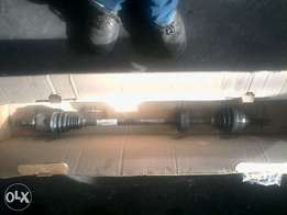 Nissan np200 brand new original complete drive shaft left and right.
