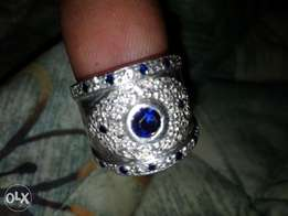 Silver wedding ring with sapphire nd white stones