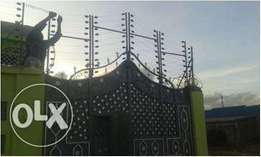 Electric fence and razor wire installation