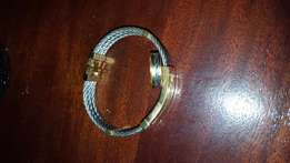 Gold and silver bracelet with gold ring