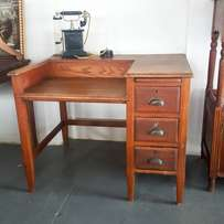 Vintage oak desk with typewriter section, sturdy condition
