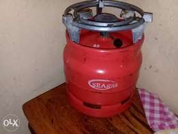 Gas cylinder complete with burner and stand