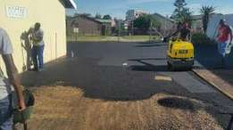 Tar surfacing and tree cutting