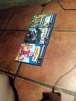 52 playstation 2 games and controlers