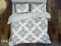 Duvets with bedsheets and a pair of pillow cases
