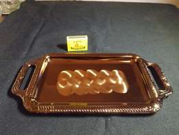 Metallic tray with pattern.