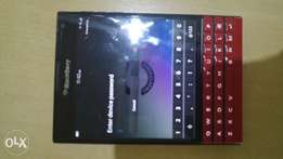 Red BlackBerry Passport in perfect condition