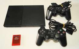 PS2 with 2 controllers & Games