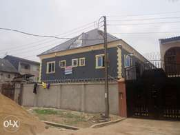 Building of four unit of three bedroom at egbeda
