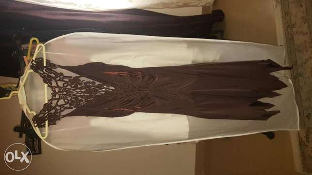 A very pretty shiny chocolate color night dress size 10 to 12( 36 - 38
