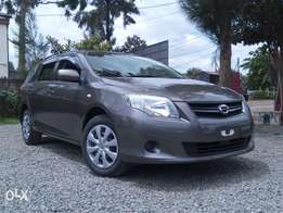 2011 Toyota Fielder. Brown in color