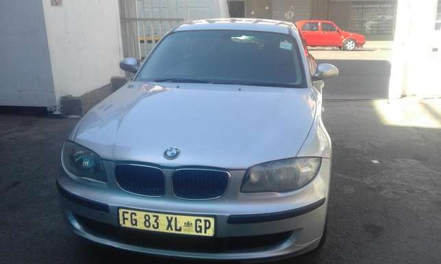 BMW 1series hatshback 2008 model silver in color 127000km R98000 Johannesburg CBD - image 1