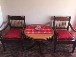 Solid wood coffee table with two riempies chairs
