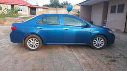 An ultra clean blue Toyota Corolla 2009 model with very low millage
