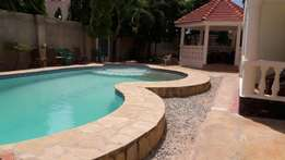 RAYOPROPERTIES 1bedroom with a swimming pool