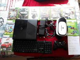 Xbox 360 and 13 games a keybord and a vr headset
