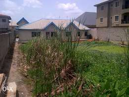 3 bedroom flat bungalow on 1 plot of land