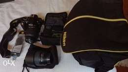 Nikon D3100 and accessories in good condition available!