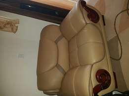 It's a leather 5 seater golden brown in colour and quit comfortable.