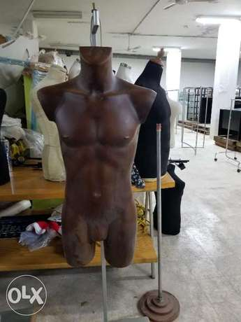 Male mannequin with stainless stand and wood base