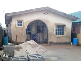Bungalow of three bed room flat and two mini flat for sale at Igando