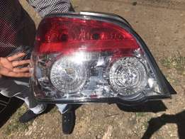 Brand new subaru saloon left tail light