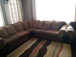 7 Seater Corner Sofa . Used for one year with extra pillow covers