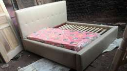 Creamy leather bed made on order.