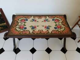Wooden bench with tapestry inlay