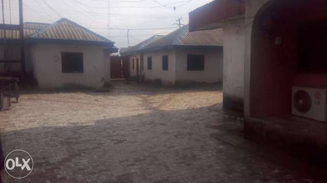 3 and half plots of land with 5 flats and shops with CofO Rumuokoro - image 1