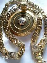 Pure gold Versace chains and pendants